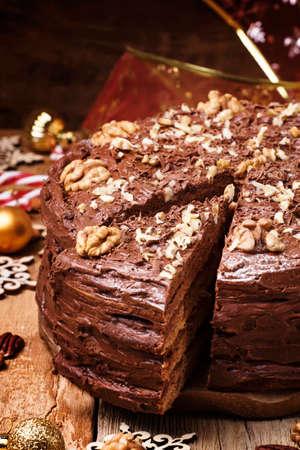Cut a piece of Christmas chocolate walnut cake, selective focus 스톡 콘텐츠