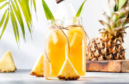 Fermented Pineapple Kombucha Drink - Tepache. Homemade probiotic superfood tea with juice. Healthy flavored drink. Copy space Imagens