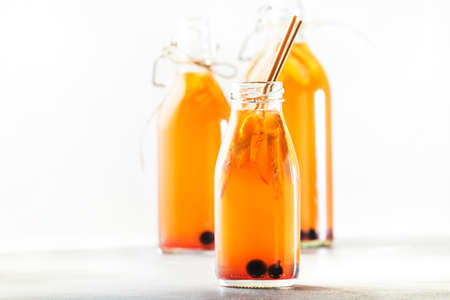 Blueberries, Cranberries Fermented Raw Kombucha With Ginger And Lemon.Tea Ready to Drink In Bottle With Eco-friendly Straw
