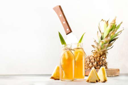 Fermented Pineapple Kombucha Drink - Tepache. Homemade probiotic superfood tea with juice. Healthy flavored drink. Copy space Reklamní fotografie