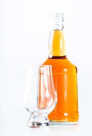 Scotch Whiskey without ice empty glass, white background, copy space Reklamní fotografie