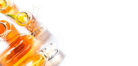 Selection Of Fermented Kombucha Drinks. Homemade probiotic superfood tea, keto diet drink, tepache, cider, kvass, ginger ale. Healthy flavored drink. Copy space. Top View Reklamní fotografie