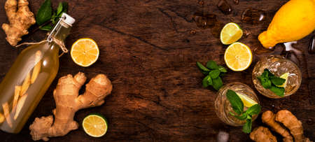 Golden Ginger Ale Beer Cocktail with Lime, Lemon and Mint in glaass on wooden table, top view with copy space Reklamní fotografie
