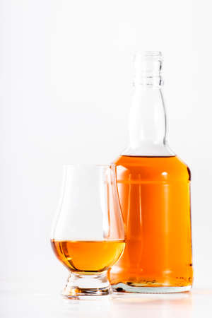 Scotch Whiskey without ice in glasses and bottle, white background, copy space Reklamní fotografie