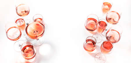 Rose wine glasses on wine tasting. Degustation different varieties of pink wine concept. White background, top view, hard light