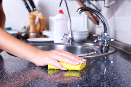 cleaning kitchen: Cleaning kitchen with sponge