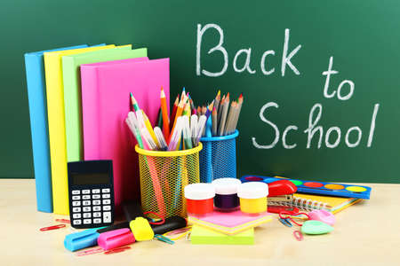 Back to school supplies. Books and blackboard. photo
