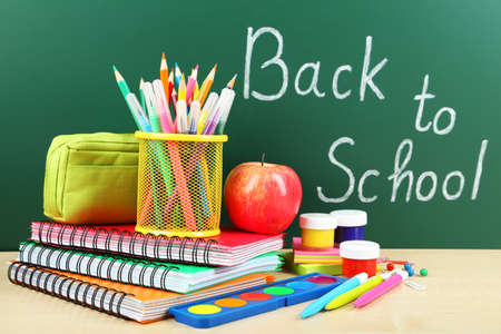 supplies: Back to school supplies. Books and blackboard.