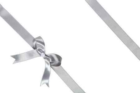 Silver ribbon with bow on white background