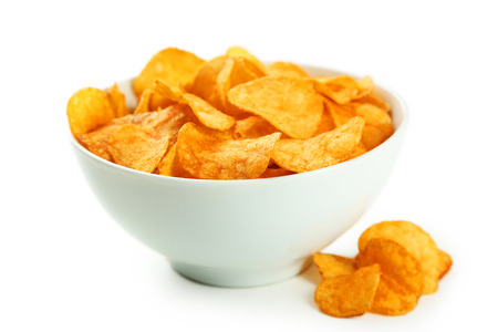 french fried potato: Potato chips in bowl isolated on white