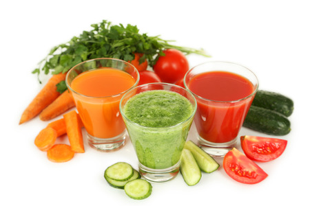 Fresh tomato, carrot and cucumber juice isolated on white