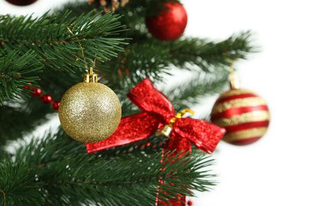 plastic christmas tree: Christmas baubles on christmas tree on white background Stock Photo