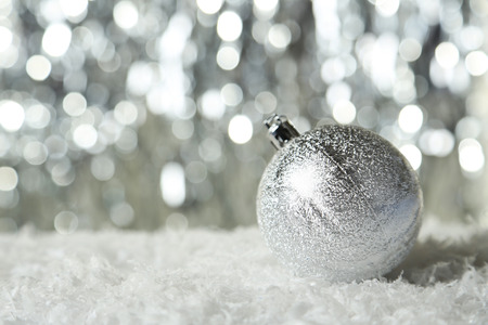 christmas ornamentation: Christmas ball on lights background