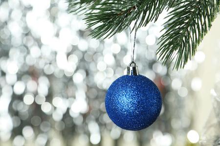 plastic christmas tree: Christmas pinecone on christmas tree on lights background