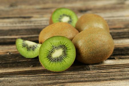 exotic fruits: Kiwi fruit on brown wooden background Stock Photo