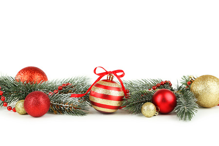 christmas ornamentation: Branch of Christmas tree with balls isolated on white