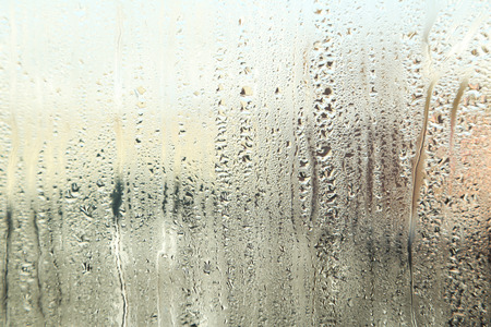 frosted window: Fogged up glass with many drops