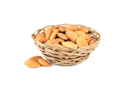 nutty: Almonds in basket isolated on white