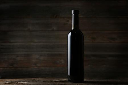 wine cork: Bottle of red wine on grey wooden background