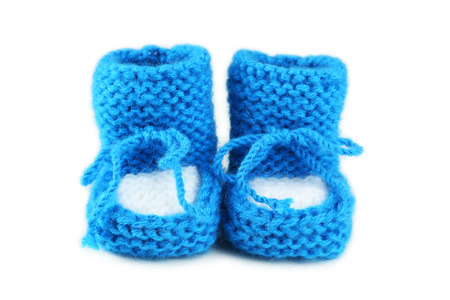 Handmade baby booties isolated on a white photo