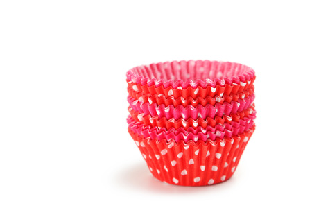 Empty colorful cupcake cases isolated on white photo