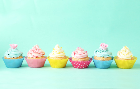 Birthday cupcakes on green background