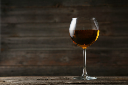 glass reflection: White wine glass on grey wooden background