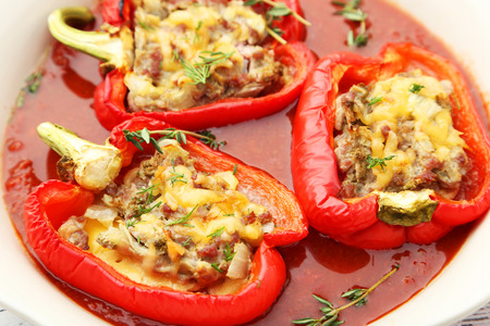 Red peppers stuffed with meat, rice and vegetables photo