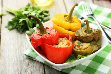 Red and yellow peppers stuffed with meat, rice and vegetables photo