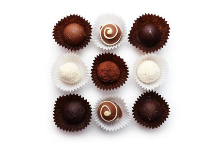 white chocolate: Chocolates on white background Stock Photo