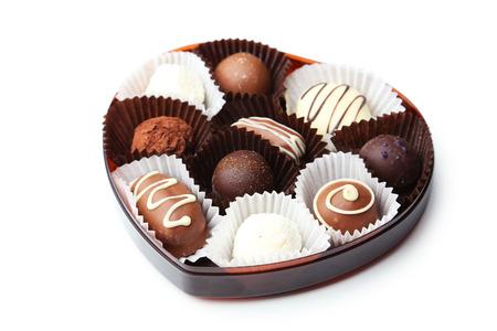 Chocolates on white background photo