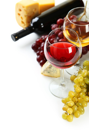 cheeseboard: Glass of red and white wine, cheeses and grapes isolated on white Stock Photo