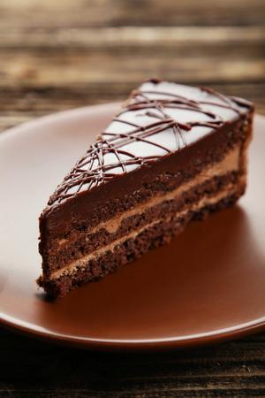 custard slices: Dark chocolate cake on brown wooden background
