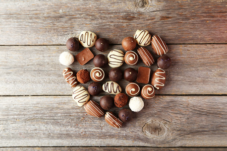 Chocolates on grey wooden background