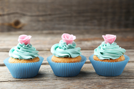 cupcakes: Tasty cupcake on grey wooden background