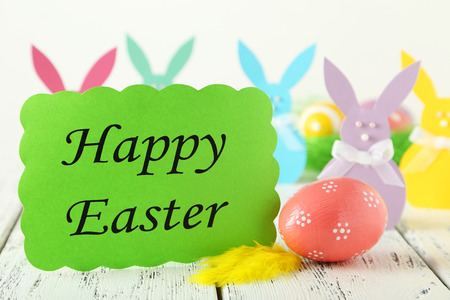 seasonal symbol: Beautiful easter rabbit on white wooden background Stock Photo