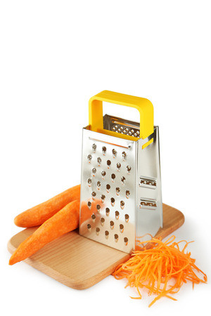 metal grater: Metal grater and carrot isolated on white