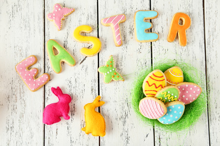Colorful easter cookies on white wooden background Stock Photo