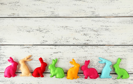 cute bunny: Handmade easter rabbits on white wooden background