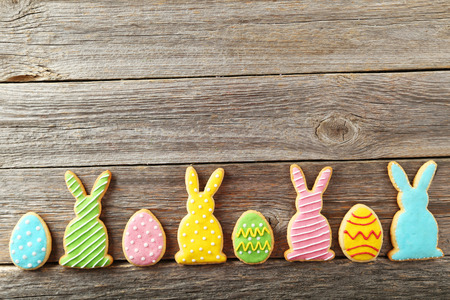 Colorful easter cookies on grey wooden background Stock Photo