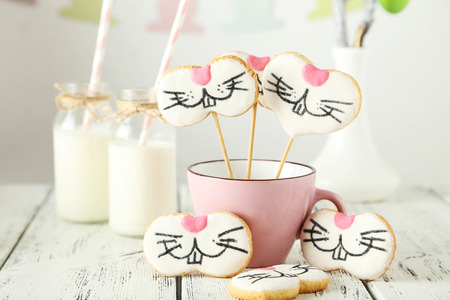 Easter cookies in cup on white wooden background photo