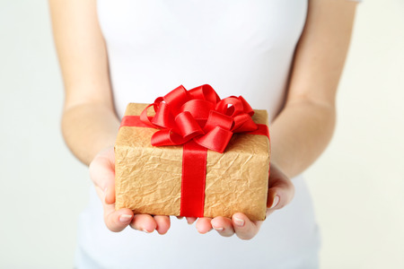 Female hands holding gift box Standard-Bild