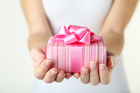 Female hands holding gift box 版權商用圖片