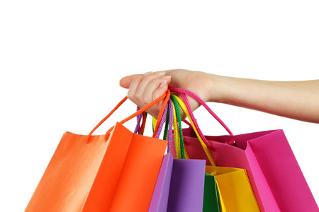 Female hand holding colorful shopping bags Standard-Bild