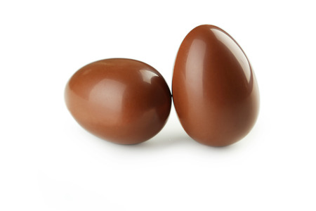 egg shape: Chocolate easter eggs isolated on white