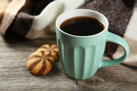 coffee mug: Cup of coffee with cookies on grey wooden background