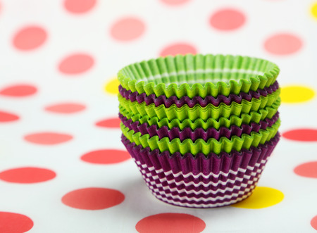 cases: Empty cupcake cases on colorful background