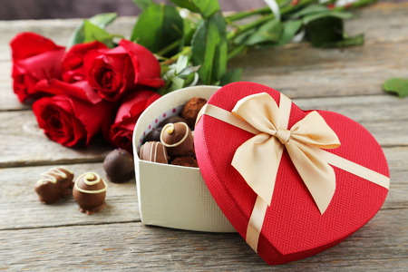 heart gift box: Beautiful heart gift box with chocolates on grey wooden background