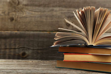 history background: Open books on grey wooden background Stock Photo