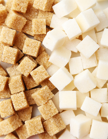 hyperglycemia: Brown and white sugar on white background
